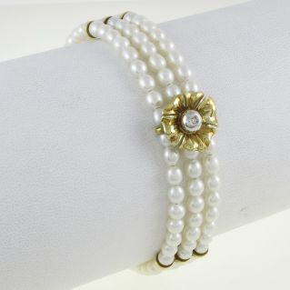 Freshwater pearls bracelet Damiani-Mikawa, 18 kt gold, central diamond Ct 2 Pt