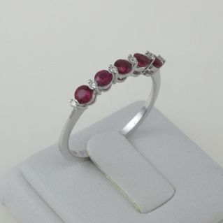 GIANNI CARITA 'Eternity ring with Rubies 0.60 Ct and Diamonds Pt 6 G/SI - 18 Kt gold