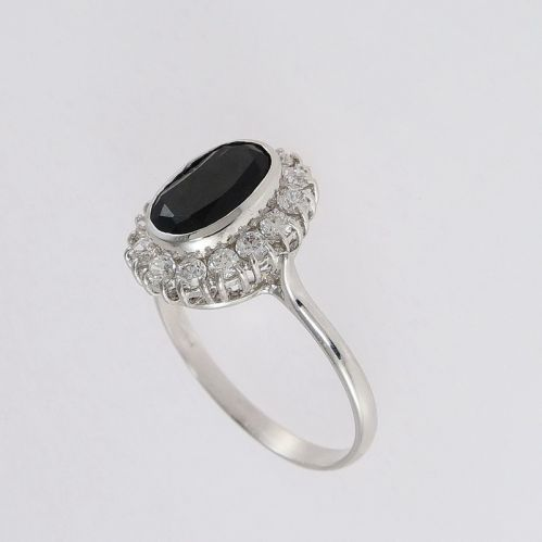 18 kt white gold ring with natural sapphire and zircons