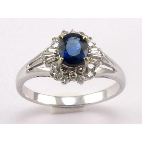 RING with 0.65 Ct central Sapphire - 0.17 Ct side Diamonds - 18 Kt white gold